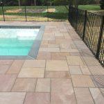 stone paver patio around a pool